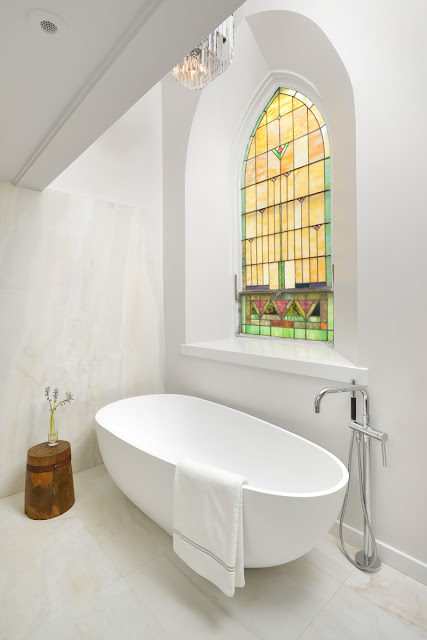 Stained glass window in modern bathroom Church conversion to chic private home Chicago
