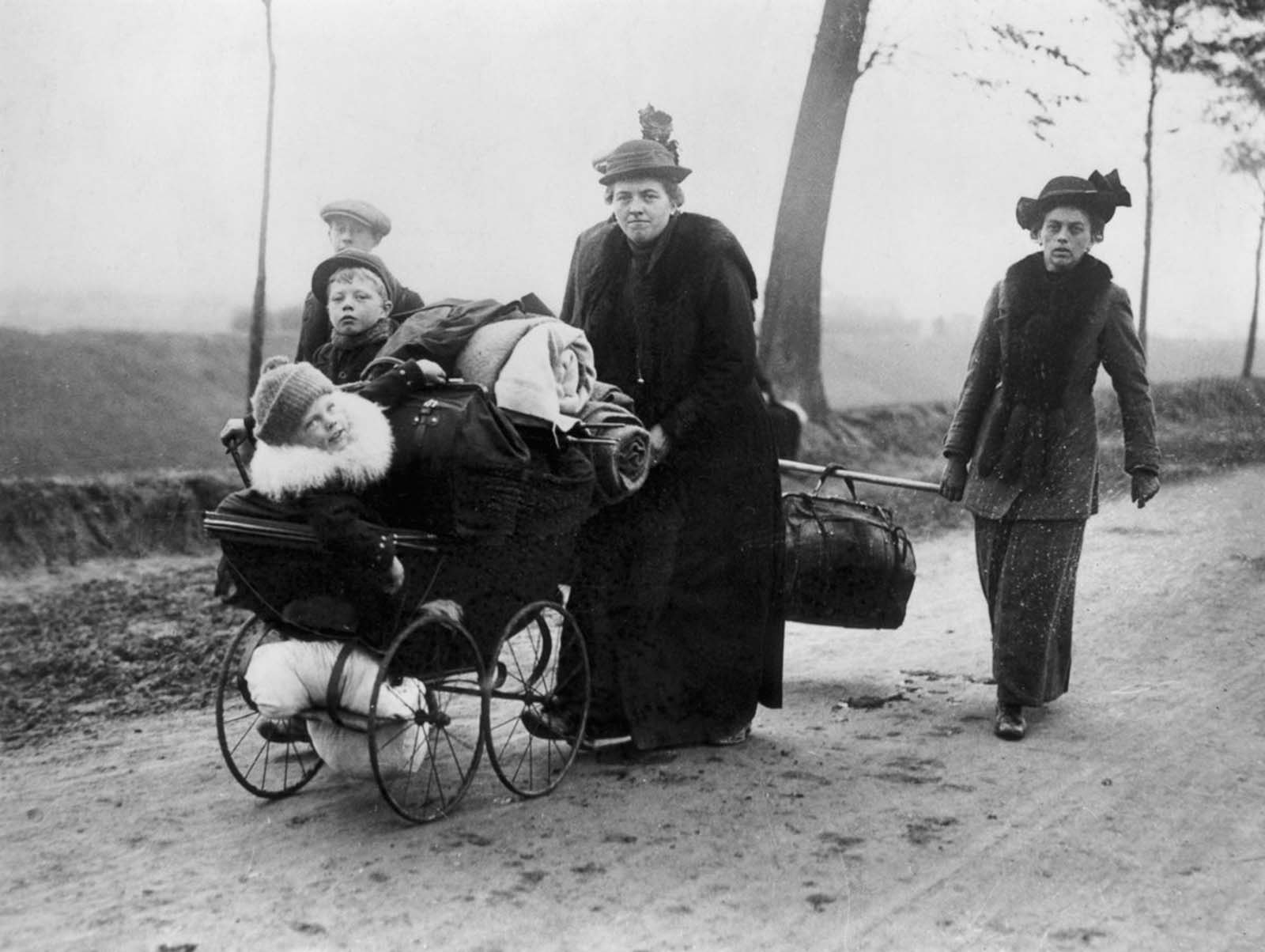 Belgian refugees carry their belongings ahead of invading troops through Northern France. 1914.