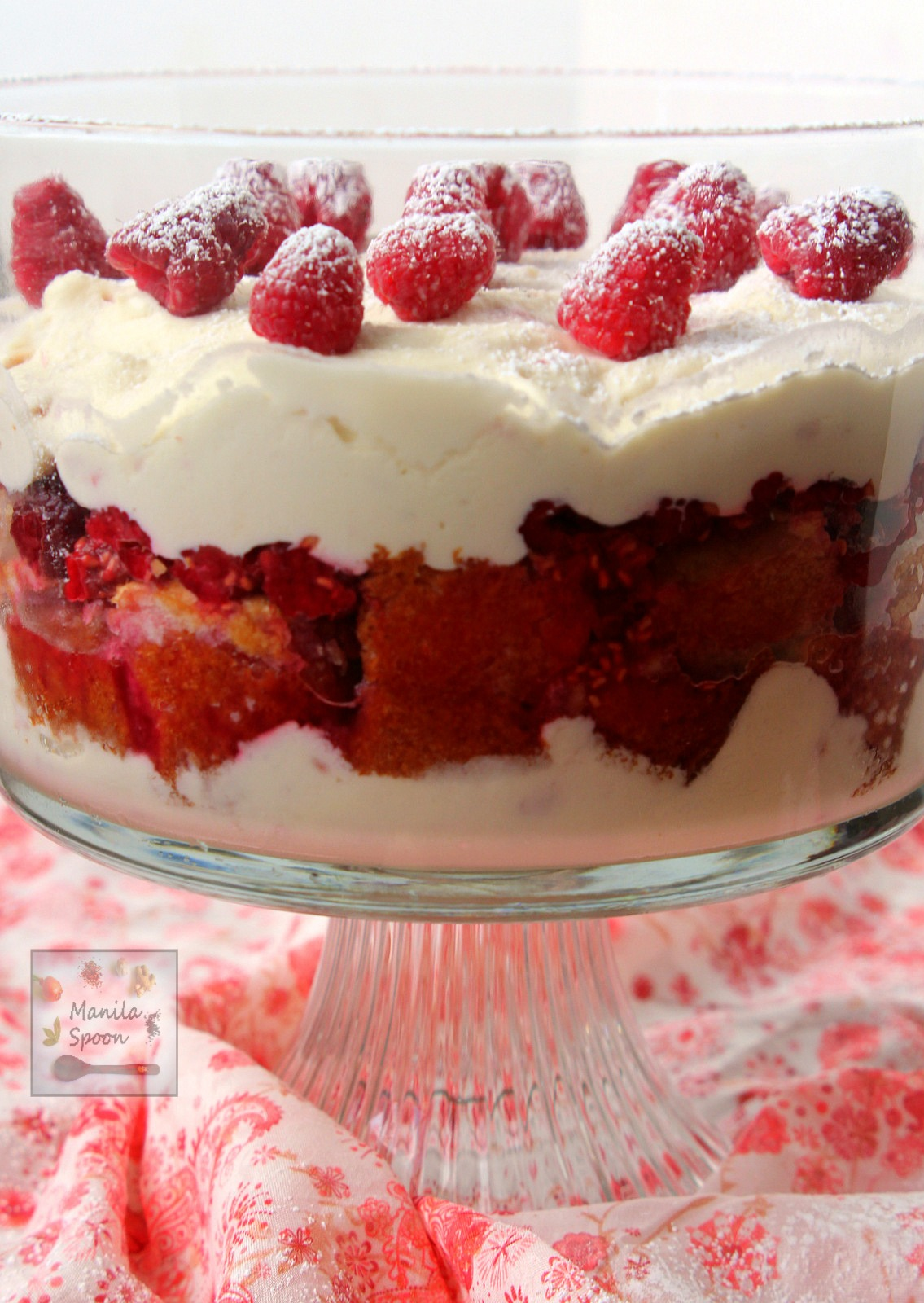 Layered with cake, white chocolate mousse and raspberries this no bake trifle is totally luscious! Quick, easy and so delicious! | manilaspoon.com