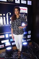 Ritika Singh in Black Printed Shirt and White Leggings at IIFA Utsavam Awards press meet 27th March 2017 03.JPG