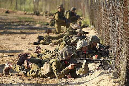 Israelis soldiers take position