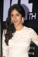 Chandini Chowdary in white Tight dress at Shamanthakamani pre release function ~  Exclusive 055.JPG