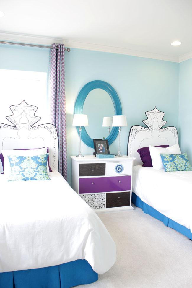 blue and purple kid's room with customized headboard
