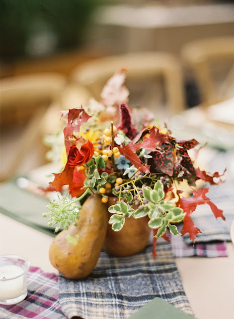 Fall center piece starring seasonal plants and a gourd