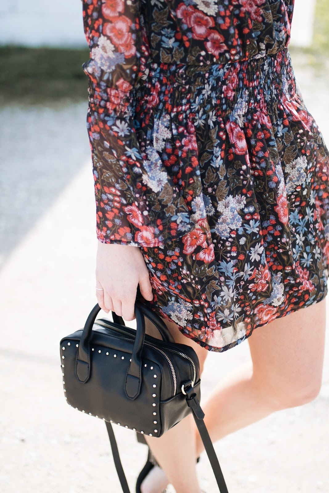 black studded bag, floral dress