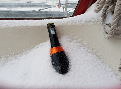 empty prosecco in snow