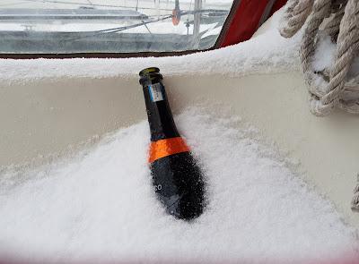 empty prosecco in snow