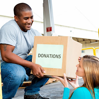 image of volunteers unloading boxes of donations
