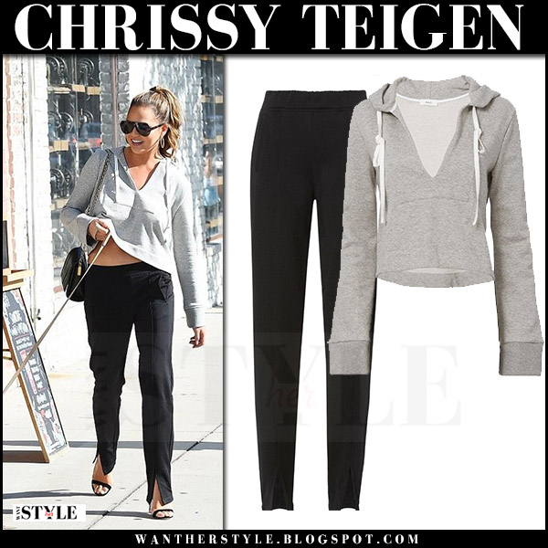 Chrissy Teigen in grey sweatshirt and black sweatpants walking her dog casual style august 2017