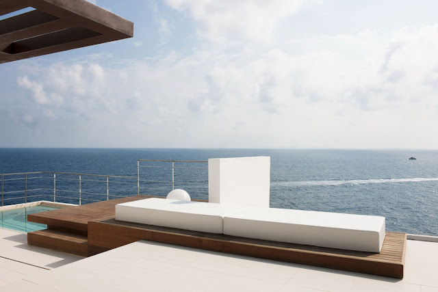 Outdoor bed on the terrace above the sea
