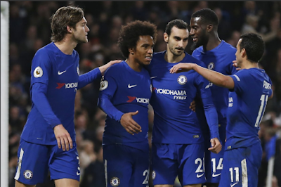 image of Chelsea players celebrating a goal