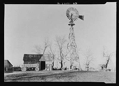 """Old-style wooden windmill in farmyard of Martin Myre's farm near Seneca, Illinois"" Credit: Library of Congress"
