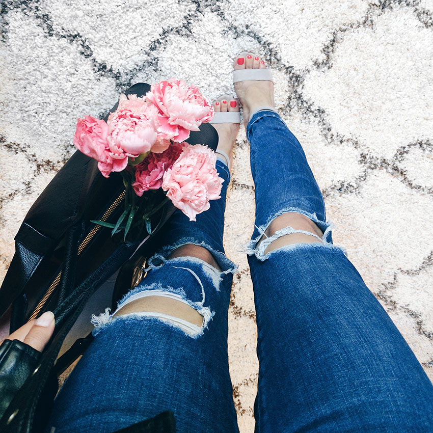 ripped denim and fresh pink flowers