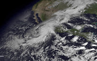 Satellite image made at 10:45 am ET and released by the US National Oceanic and Atmospheric Administration (NOAA) on 23 Oct. 2015 shows Hurricane Patricia (L) as it approaches the coastline of Mexico from the Eastern Pacific. (Credit: EPA/NOAA / Handout) Click to Enlarge.