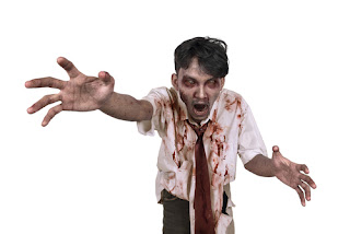 A zombie man in a white shirt and red tie lunging out from the page