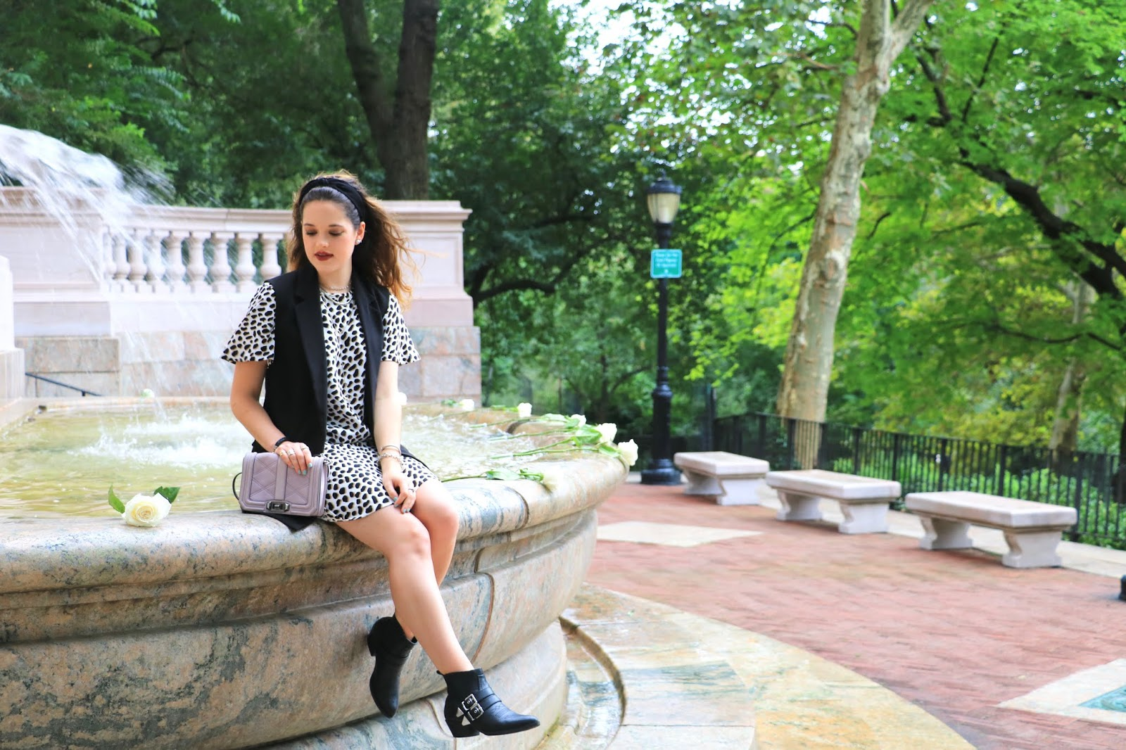 Nyc fashion blogger Kathleen Harper showing how to wear a leopard dress