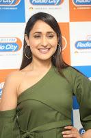 Pragya Jaiswal in a single Sleeves Off Shoulder Green Top Black Leggings promoting JJN Movie at Radio City 10.08.2017 129.JPG