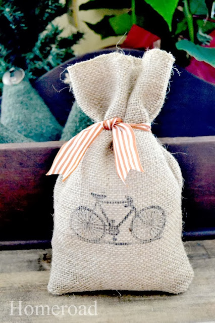 burlap gift bag with orange striped bow and bicycle