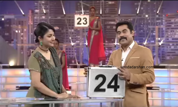 Suraj Venjaramoodu with actress Meera Jasmine in the first episode of Deal or No Deal 2 on Surya TV