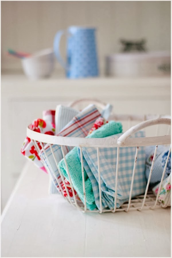 A wire basket full of fabric - 24 Amazing Storage Ideas That You Will Freakin' Love!