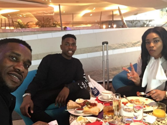 Jay Jay Okocha Pictured With His Son & Beautiful Daughter At Heathrow Airport
