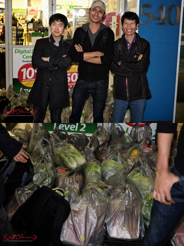 Three Korean guys at Town Hall Woolies with their shopping.