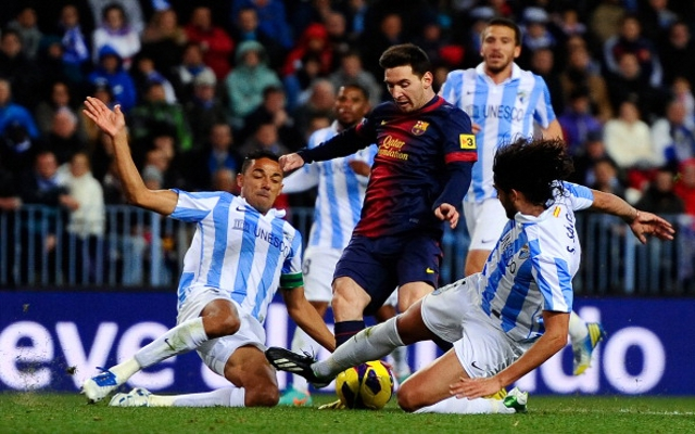 Messi Surrounded by Malaga Players