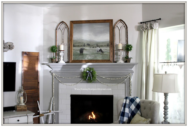 French Country Farmhouse Fireplace-Arched Window-Cow Artwork-Button Garland-Vintage Style-Buffalo Check-From My Front Porch To Yours