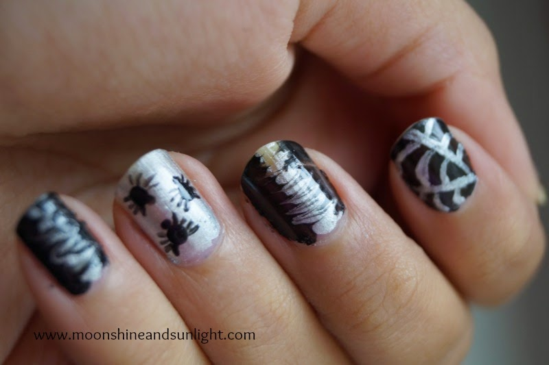 Tiny spider halloween nail art , Black and silver halloween nails