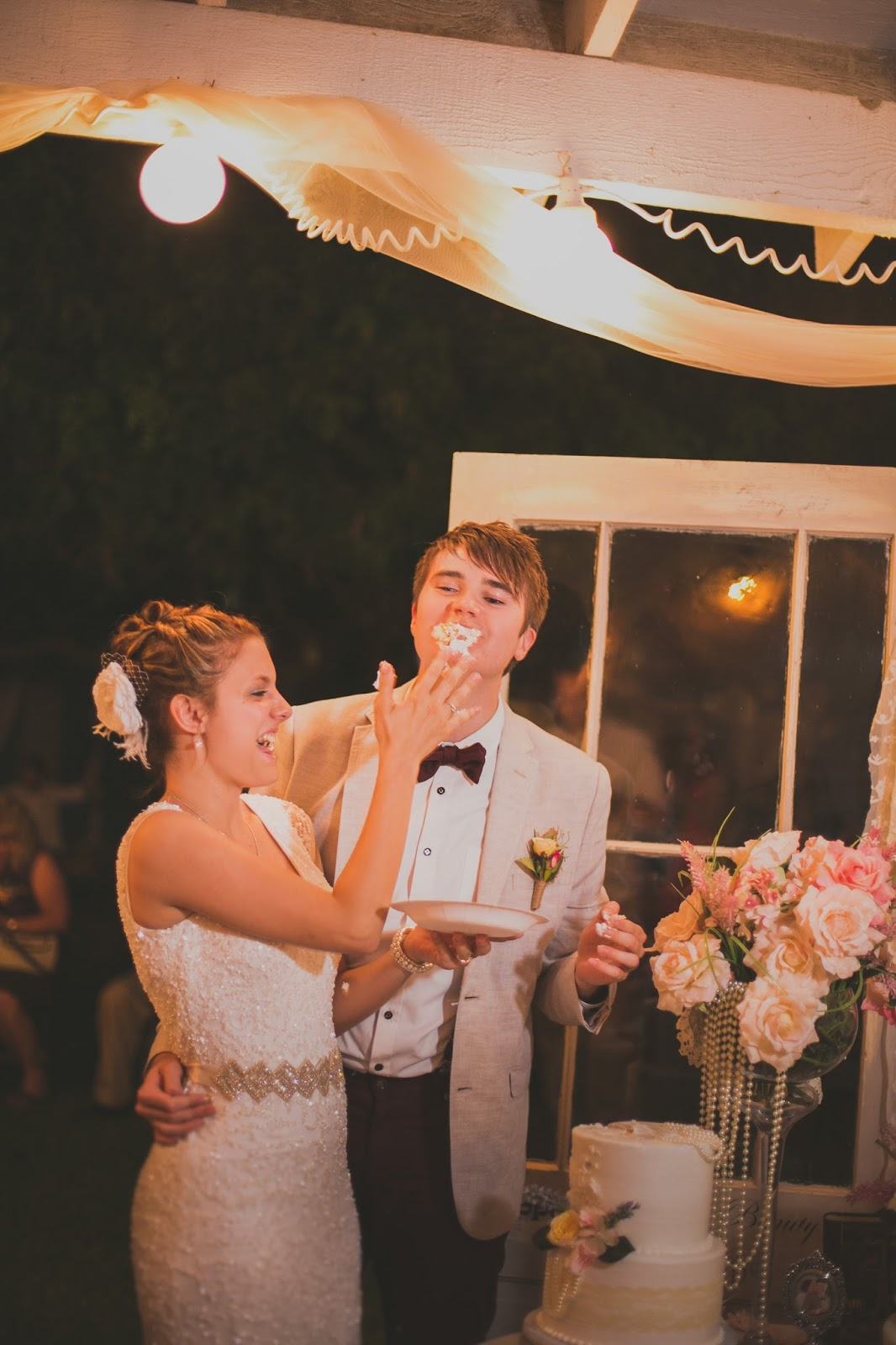 smashing of the cake in the grooms face
