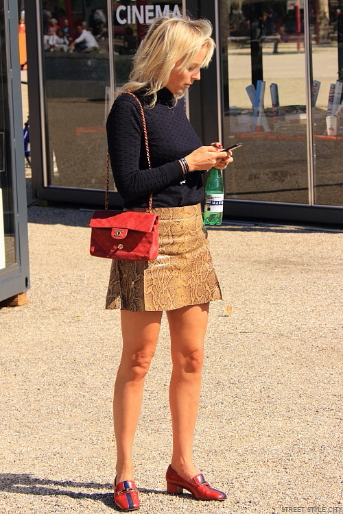 Short sexy female legs wearing snake skin print leather mini skirt at the amsterdam fashion week 2018. Street style fashion candid look outfit ootd