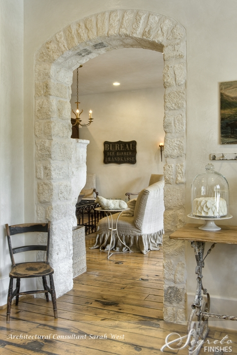 Rustic antique wood floors, reclaimed stone, Segreto Finishes plaster walls and design details in a beautiful French country home with Old World style.