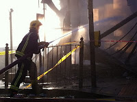 Fireman dousing the flames