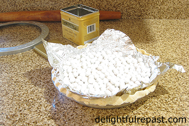 Perfect Pumpkin Pie (this photo - unbaked pie shell filled with pie weights) / www.delightfulrepast.com