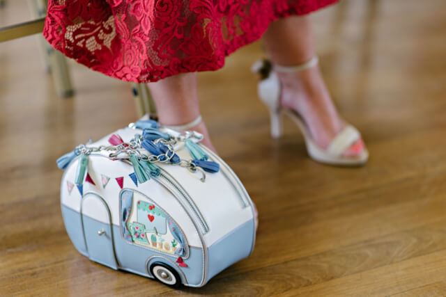 Vendula London caravan bag at vintage seaside wedding