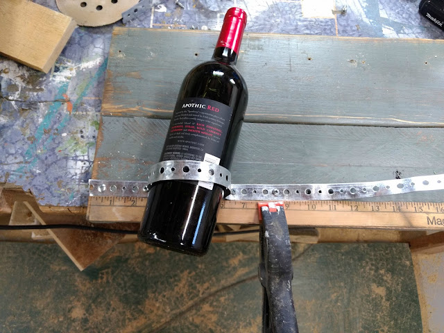 use plumbers tape to make wine holders