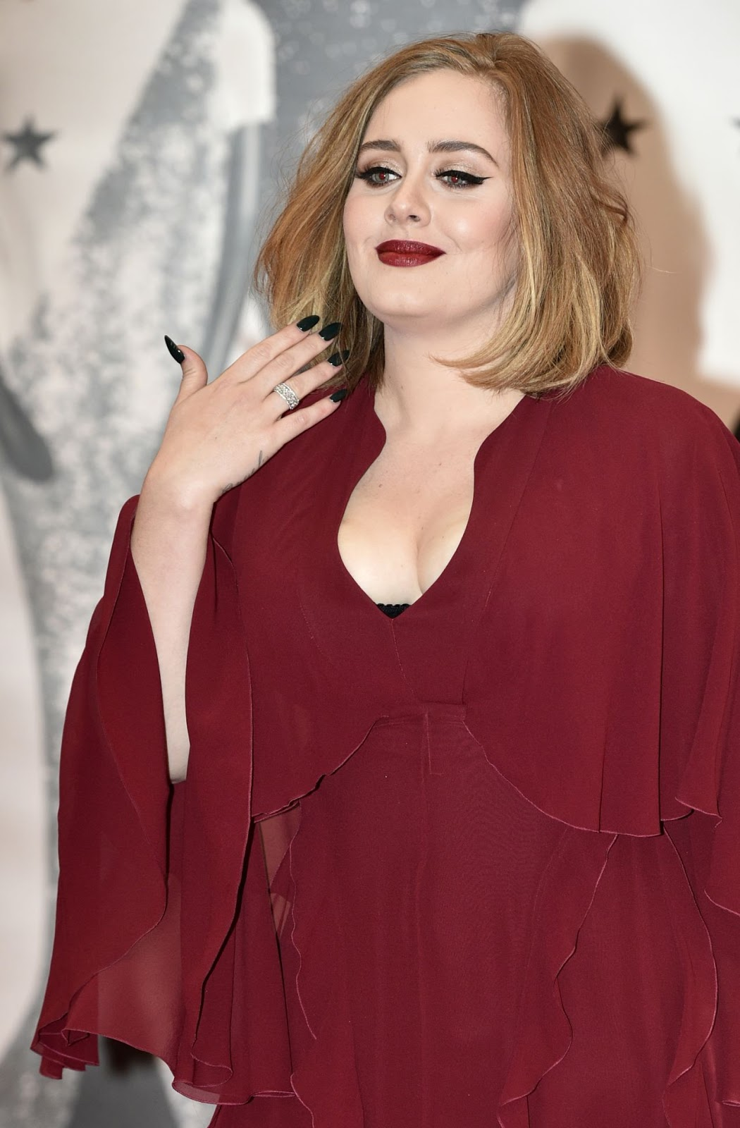 Adele bares cleavage at the Brit Awards 2016