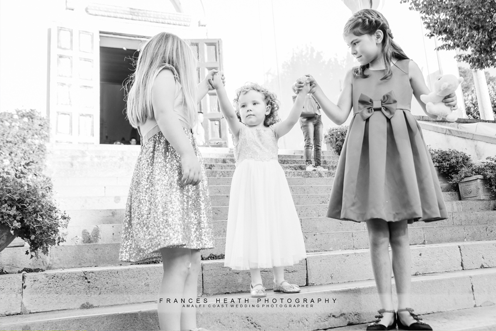 Kids playing on the steps infront of the church before wedding ceremony
