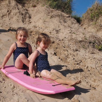 Bodyboarding down the sand dunes at Holywell Beach