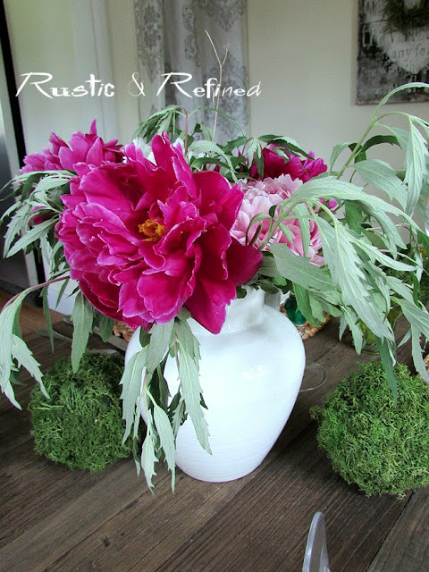 Moss balls and peonies in a tablescape