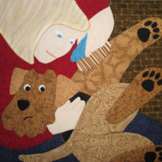 Applique of Airedale being groomed or Airedale Terrier rescue quilt