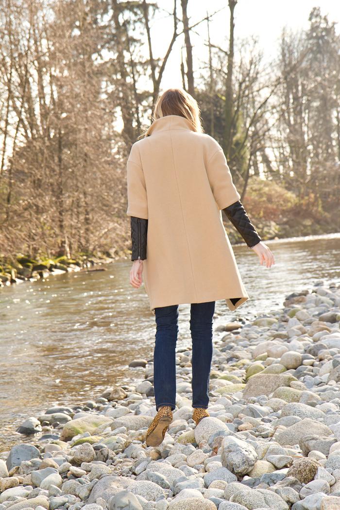 Vancouver Fashion Blogger, Alison Hutchinson, wearing Zara camel coat with black leather sleeves, Zara black basic t-shirt, BDG skinny blue jeans, Zara leopard print loafers, H&M black sunglasses