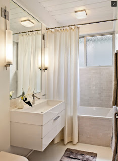fancy small bathroom design plus twin wall lights also white shower curtain and drop in bathtub