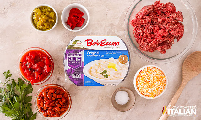 Ingredients: ground beef, chili beans, tomatoes, diced green chiles, tomato paste, potatoes and cheese