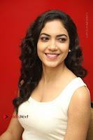 Actress Ritu Varma Stills in White Floral Short Dress at Kesava Movie Success Meet .COM 0187.JPG