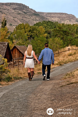 a couple walks into a colorado landscape for their engagement session