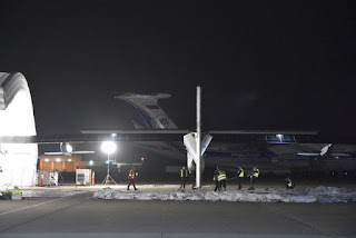 Rear view of Solar Impulse 2 being pulled from its hangar, Moffett Field, Mountain View, California