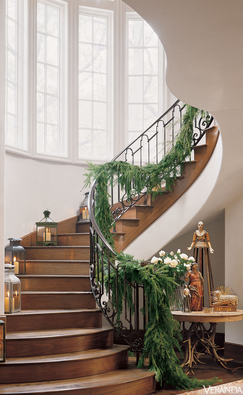 Magnificent winding French staircase with garland and Christmas decor - Pamela Pierce.