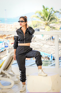 Neha Malik Hot Cleavage Photos in Black Dress