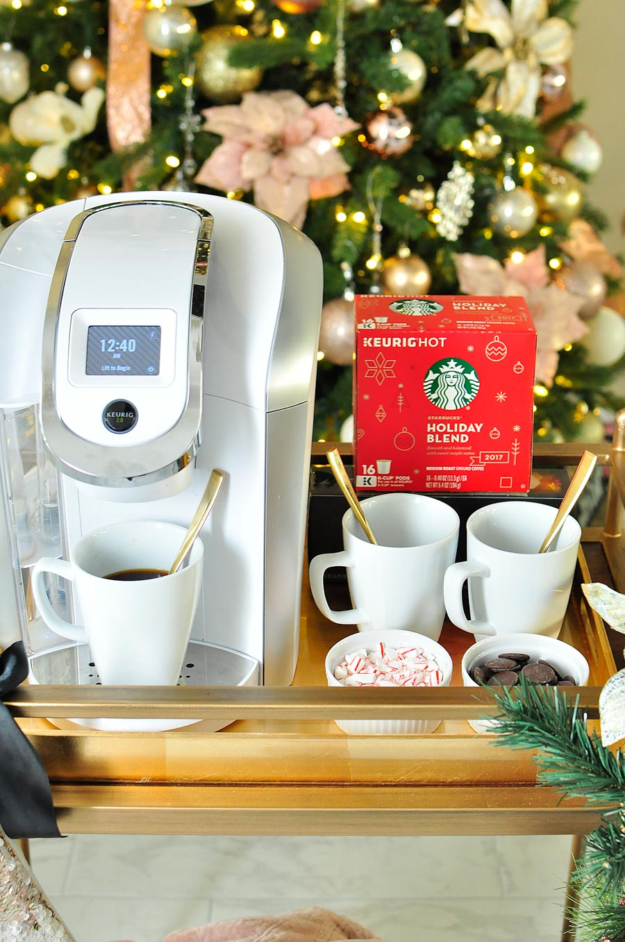 Turn a bar cart into a portable coffee cart (or coffee station) with Starbucks coffee and a Keurig. Perfect for a cozy holiday with the family!